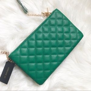 Green quilted cross body bag